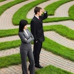Business-Man-and-Woman-Corporate-Maze-500px-w